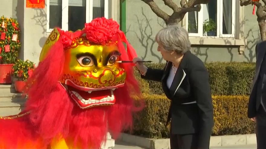 British Prime Minister Theresa May enjoys a lion dance