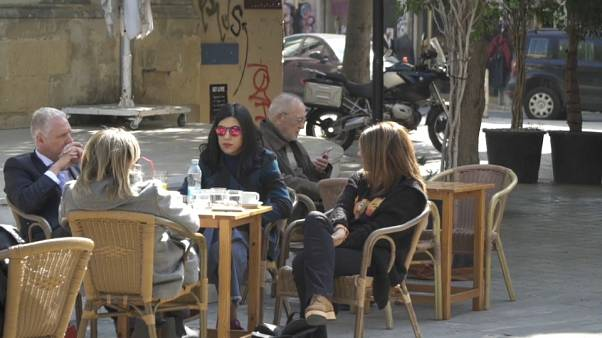 Young Cypriots relax in a cafe in Nicosia