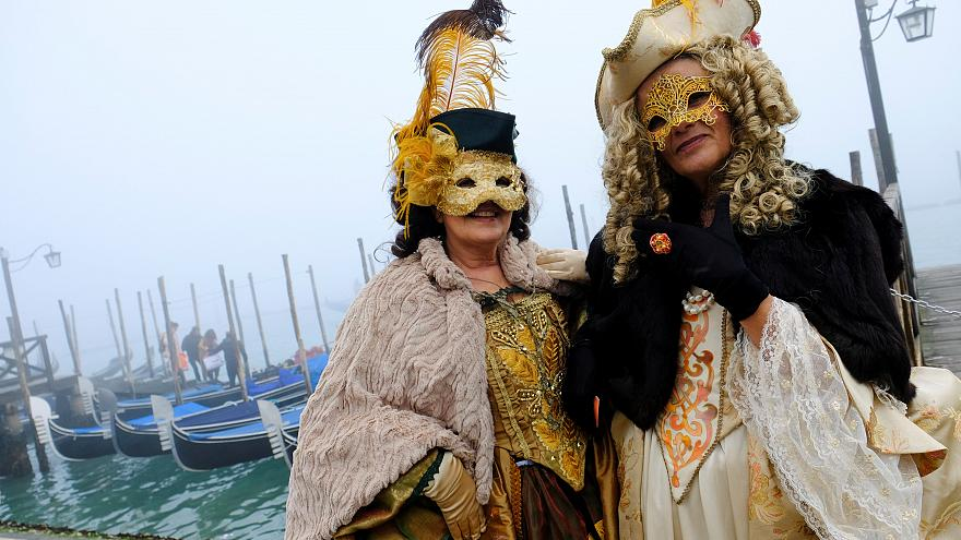 Masked revellers pose during the Carnival in Venice
