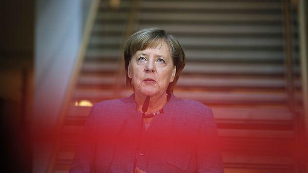 German Chancellor Angela Merkel arrives for coaltion talks at the SPD HQ