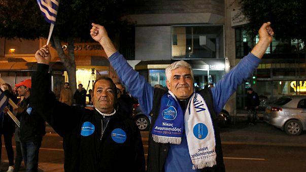 Supporters of incumbent president Nicos Anastasiades celebrate