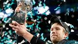 Philadelphia Eagles quarterback Nick Foles lifts Super Bowl LII