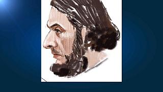 Ritratto di Salah Abdeslam sul banco degli imputati a Bruxelles