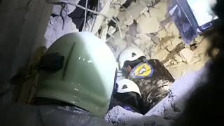 White Helmets rescue a baby from the rubble after airstrikes in Idlib