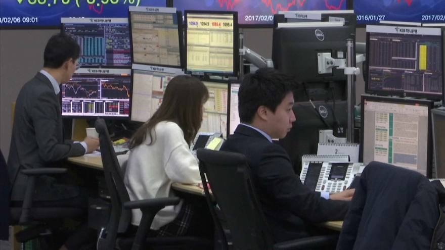 Traders watch stocks slide after shares dropped on Wall Street