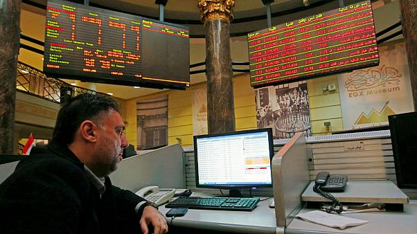 A trader works at the Egyptian stock market in Cairo