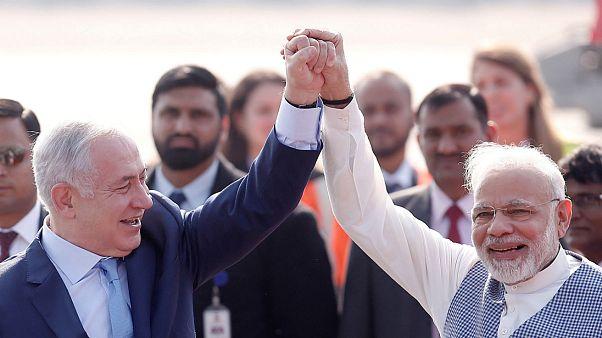 Israeli Netanyahu and hisIndian Narendra Modi raise their arms New Delhi