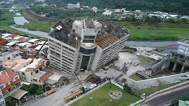 Dozens may remain trapped in the tilted Yun Tsui building.