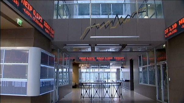 Greece issues 7-year bond in tentative return to financial market