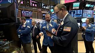 Wall Street recovered some ground on Friday after huge losses previously