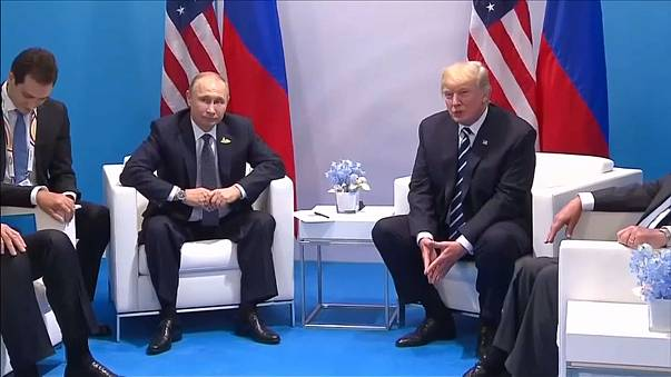 Vladimir Putin with Donald Trump at a summit in 2017