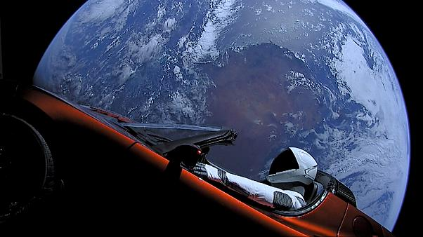 A car floats through space after it was carried by SpaceX's Falcon Heavy