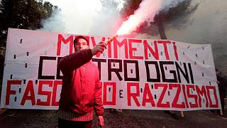 """A banner reads """"Movements against fascism and racism"""" in Macerata, Italy"""