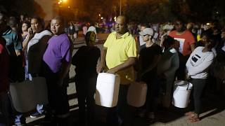People queue to collect water in Cape Town, South Africa
