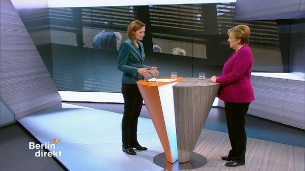 Merkel defends coalition deal on German TV