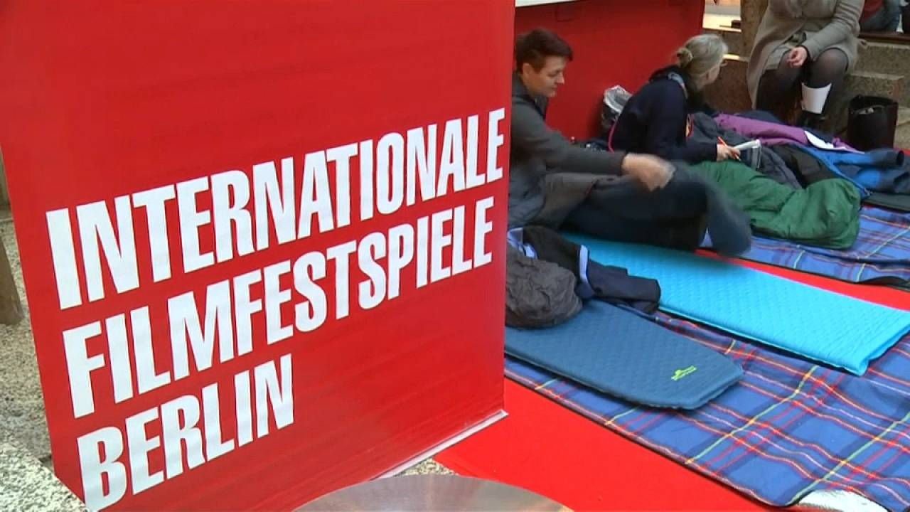 People wait to buy tickets at the Berlin Film Festival