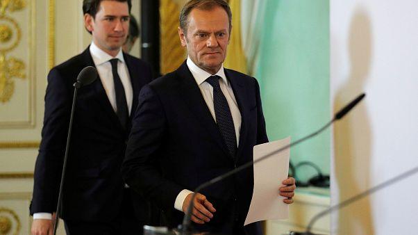 Sebastian Kurz (L) and Donald Tusk arrive for a media statement in Vienna