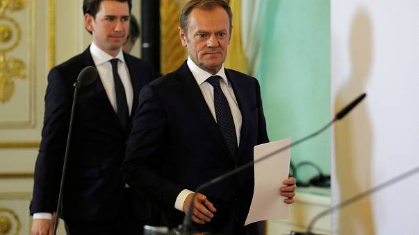 Sebastian Kurz (L) and Donald Tusk arrive for a media statement in Vienna