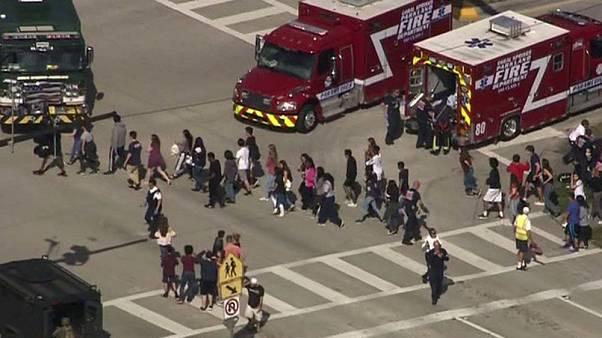 Students are evacuated from Marjory Stoneman Douglas High School during a s