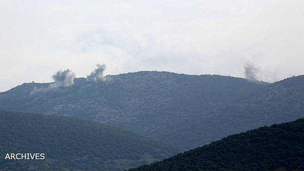 Smoke rises on the mountains as seen from Northern Afrin countryside, Syria