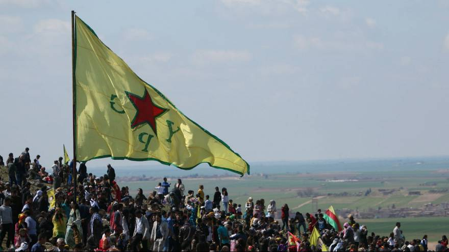 A Kurdish People's Protection Units (YPG) flag flutters