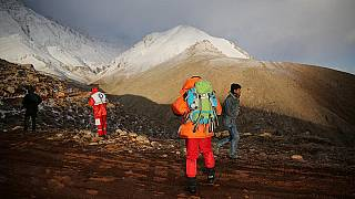 Search teams look for the wreckage of the flight