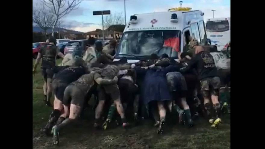Rugby players form 'scrum' to free ambulance stuck in mud