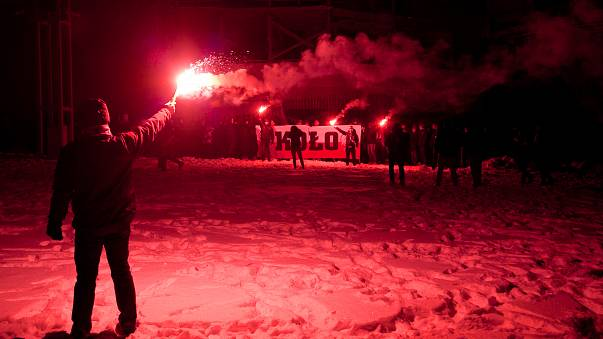 Supporters of far right groups hold flares in Poland