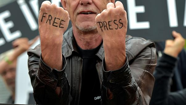 A man takes part in a protest organised by Amnesty International