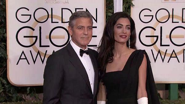 جورج كلوني وزوجته يتبرعان بنصف مليون دولار للناجين من حادث باركلاند