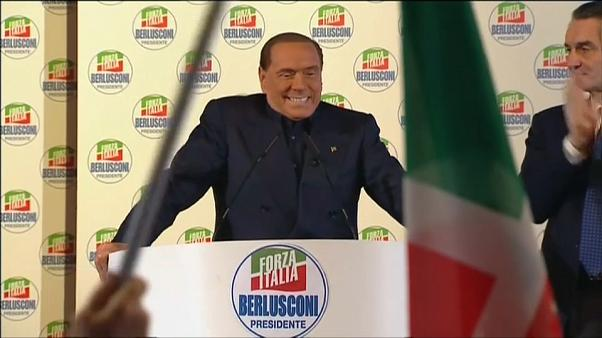 Despite a ban from public office former Italian Prime Minister Silvio Berlusconi addresses supporters as the national election campaign intensifies