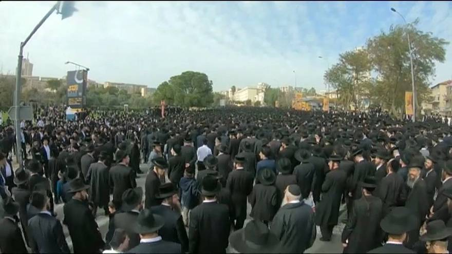 Thousands of mourners packed the streets to pay their respects