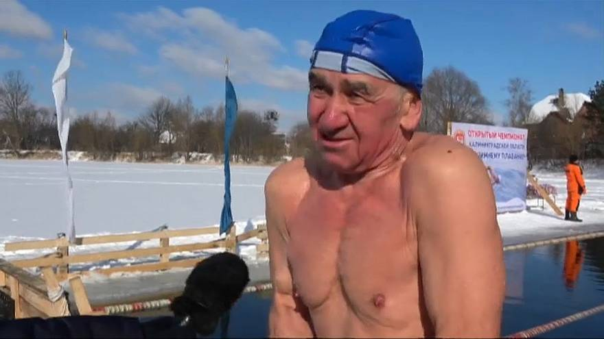 Russian ice swimmers brave -10C temperatures