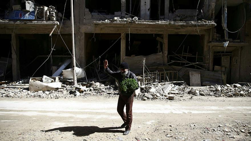 Man in besieged town of Douma in Eastern Ghouta in Damascus, Syria