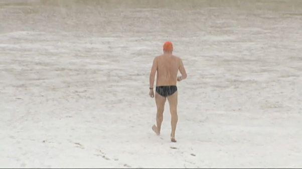 Brave swimmer in San Sebastian, Spain goes for a dip