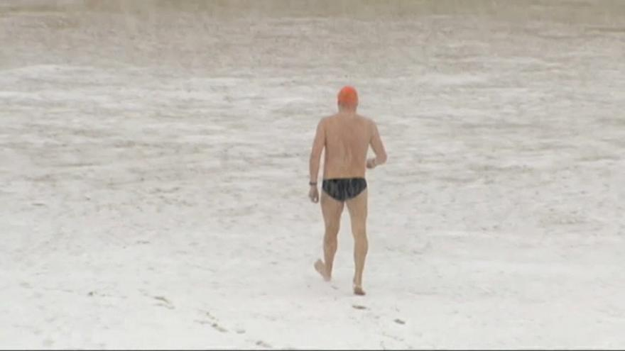 Brave swimmer in San Sebastian, Spain goes for a dip