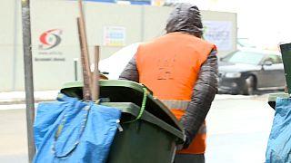 Homeless man walks down freezing street in Budapest