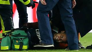 PSG Neymar receives treatment from medical staff after sustaining an injury