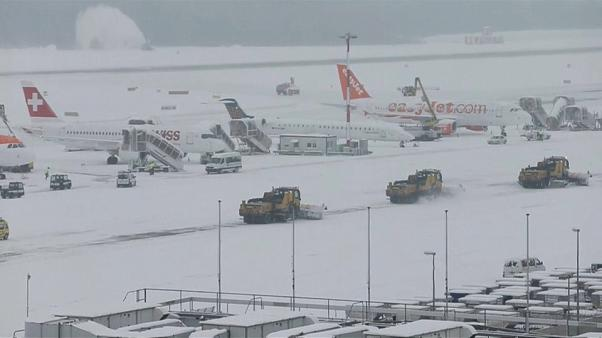 Snow ploughs clear snow from Geneva airport