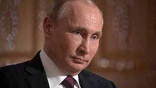 Putin denies 'new Cold War' but says new nukes are on 'combat duty'