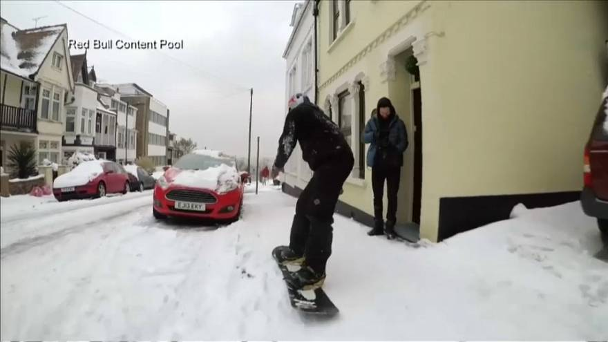 British Olympic bronze medallist Billy Morgan snowboards down street