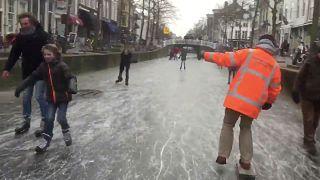 Watch: People skate on frozen Dutch canals