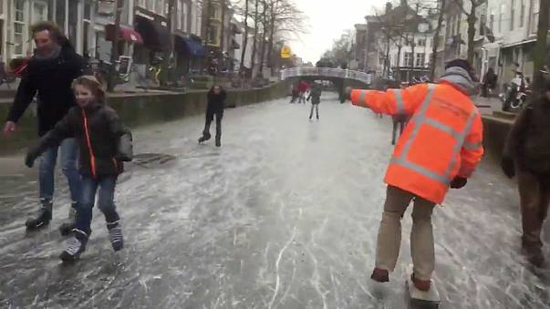 Watch: People skate on frozen Dutch canals