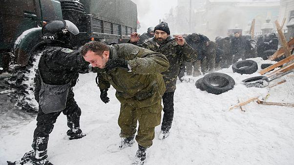 Ukraine: police raid protester camp