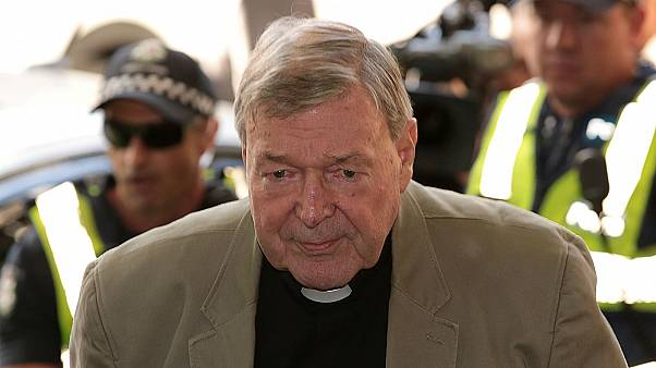 Cardinal George Pell arrives at Melbourne Magistrates Court in Melbourne