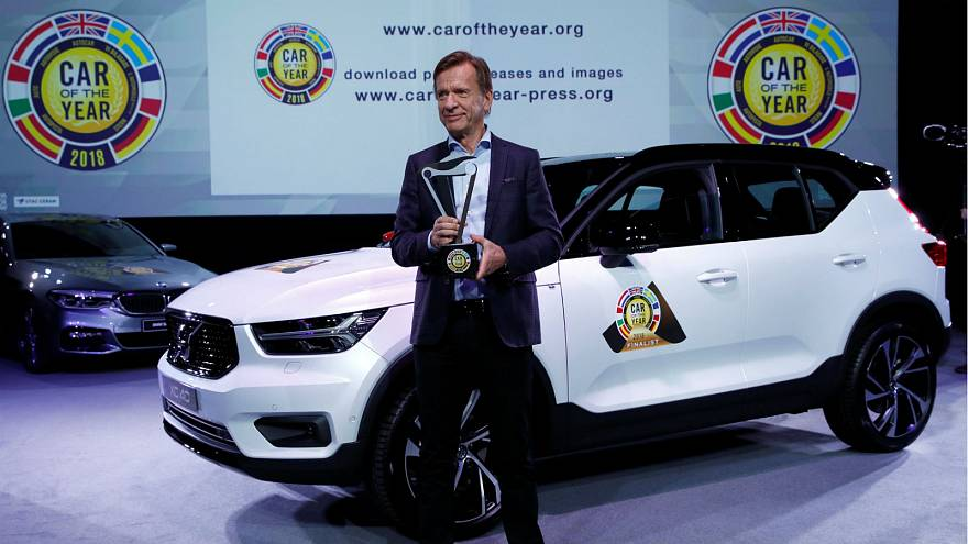 Volvo Car Group CEO Hakan Samuelsson poses next to the Volvo XC40