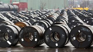 Stored rolls of steel are seen outside the ArcelorMittal Dofasco plant