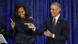 Former U.S. President Obama and first lady Michelle Obama