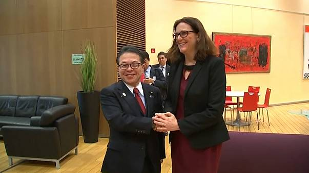 Japanese Trade Minister Hiroshige Seko and EU trade chief Cecilia Malmstrom