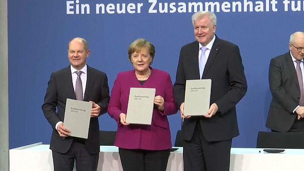 "Angela Merkel says ""it's time to start work"""